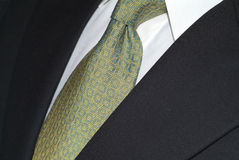 Silk necktie and dark suit Stock Photography