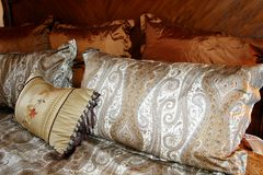 Silk Paisley Pillows. Beautiful silk paisley pillows in rich colors royalty free stock photos