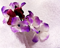 Silk pansies & towels Stock Photo