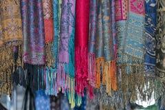 Silk pashmina on display sand for sale Stock Photography