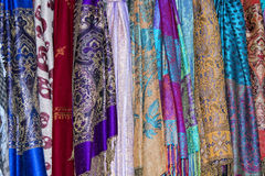 Silk pashmina on display sand for sale Stock Images