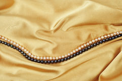 Silk and pearls Stock Image