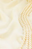 Silk with pearls. Pastel silk with pearls border abstract background stock photo