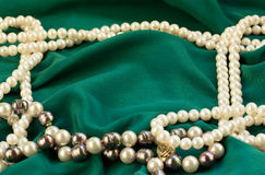 Silk with pearls Stock Photos