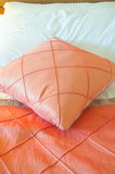 Silk pillow on bed Stock Photos