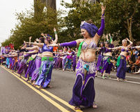 Silk Road Shimmy. SEATTLE, WA - JUNE 16, 2012: A line-up of belly dancers in the Silk Road Performance Troupe perform during the annual Fremont Summer Solstice Stock Images
