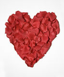 Silk Rose Petal Heart. Red silk rose petals in a heart shape isolated on a white background Royalty Free Stock Images