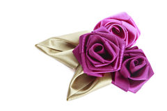 Silk roses. Three pink handmade silk roses on white background Royalty Free Stock Photography