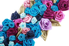 Silk roses. Blue, vinous, pink and turquois handmade silk roses on white background Stock Image