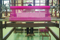 Silk rug weaving on a hand loom in Thailand Royalty Free Stock Image