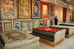 Silk Rugs on Display and for Sale. In Shanghai, China (salesman is not recognizable Stock Photography