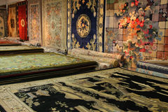 Silk Rugs on Display and for Sale Stock Photos