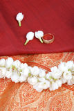 Silk saree. With wedding ring and jasmine flowers, indian traditional stock images