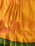 Silk Sari. Closeup of two-color silk sari with artistic green border Royalty Free Stock Images