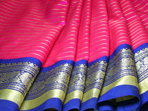 Silk Sari. Silk saree with focus on its exquisite border Royalty Free Stock Photo
