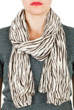 Silk scarf. Beige silk scarf around her neck  on white background. Royalty Free Stock Image