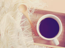 Silk scarf with black coffee and spoon on wooden tray Royalty Free Stock Photography