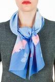 Silk scarf. Blue silk scarf around her neck  on white background. Royalty Free Stock Photo