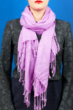 Silk scarf. Lilac silk scarf around her neck isolated on blue background. Stock Photography