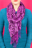 Silk scarf. Lilac silk scarf around her neck isolated on pink background. Stock Photos