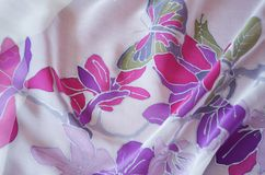 Hand painted silk scarf. Beautiful butterfly and flowers. Silk scarf with painted flowers and butterfly. Original art work on bright background royalty free stock images
