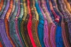 Silk shawls in different colors for sale. Laos stock photos