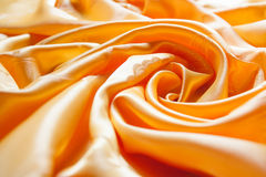 Silk. Smooth elegant golden silk or satin can use as background Royalty Free Stock Photo