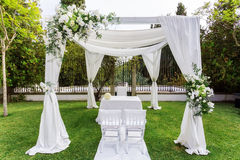 Silk tent for the wedding ceremony for the newlyweds. The garden in countryside. Stock Photography