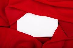 Silk textile border around white paper royalty free stock photography
