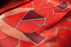Silk Texture. Texture and pattern found on a piece of red silk cloth royalty free stock image