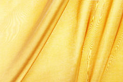 Silk textured for background, gold color. Stock Images
