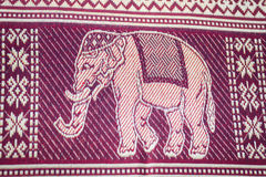 Silk thai. Thailand elephant silk woven by hand, which expresses the identity of the people of Thailand Royalty Free Stock Photo