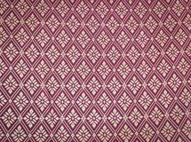 Silk thai. Thailand silk woven with motifs like flowers in the squares of many flowers that expresses the identity of the people of Thailand Royalty Free Stock Images
