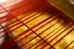 Silk thread line from hand weave loom. With warm and low indoor lighting blury and low detail subject concept stock images