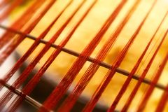 Silk thread line from hand weave loom. With warm and low indoor lighting blury and low detail subject concept stock photography