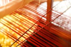 Silk thread line from hand weave loom. With warm and low indoor lighting blury and low detail subject concept stock photo