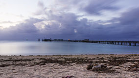 Silk water in the pier Royalty Free Stock Photo