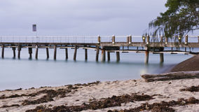 Silk water in the pier Royalty Free Stock Photography