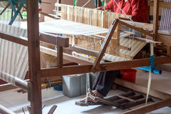 Silk weaving on a hand loom Stock Photos