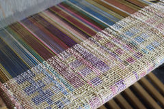 Silk weaving on a loom Royalty Free Stock Photography