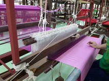 Silk Weaving by Loom Royalty Free Stock Images