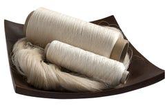 Silk yarn skein and bobbins Stock Photo