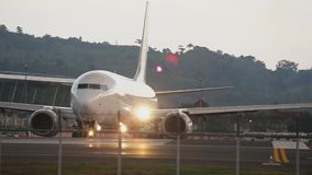 SilkAir Boeing 737 taxiing. PHUKET, THAILAND - NOVEMBER 30, 2018: SilkAir Boeing 737 9V-MGJ taxiing before departure from Phuket airport stock video footage
