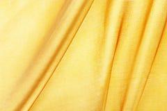 Silke som textureras för bakgrund, guld- färg Arkivbilder