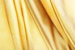 silke som textureras för bakgrund, guldbruntfärg Royaltyfri Bild