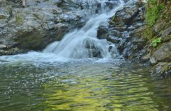 Silken cascade of Little Metis River feeds local swimming hole Stock Photography