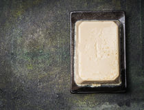 Silken tofu on dark rustic background, top view Royalty Free Stock Images