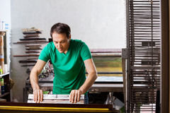 Silkscreen artist in Atelier Stock Image