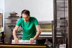 Silkscreen artist in Atelier. Creating artwork stock image
