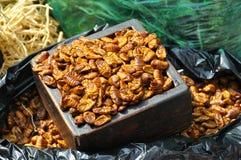 Silkworms. Edible Thai silkworm larvae in a market in Asia Stock Photo